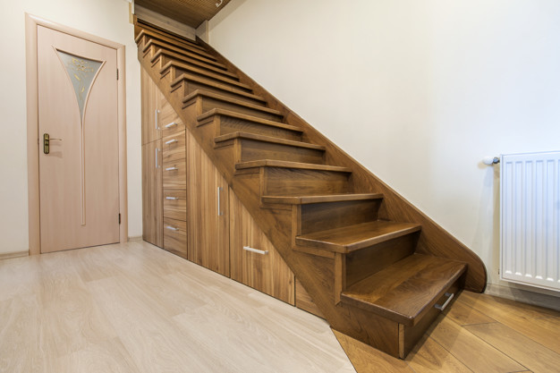 Modern architecture interior with luxury hallway with glossy wooden stairs in modern storey house. custom built pullout cabinets on glides in slots under stairs Premium Photo