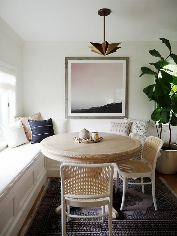 neutral breakfast nook styling with vintage rug and cane dining chairs coco kelley #breakfastnook #diningroom